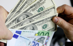 The dollar depreciates against foreign currencies within the correction