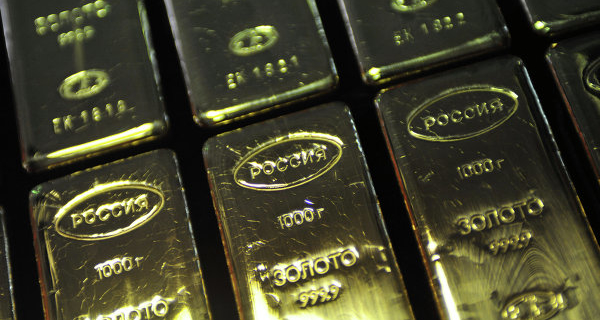 Gold traded near the lowest in three months