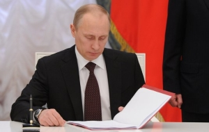Putin signed a law on pledge for fee payment through terminals