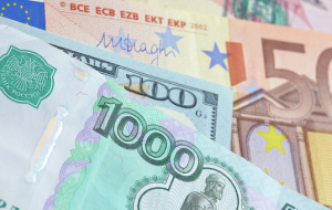 The ruble began the day with a slight increase to the dollar and decrease to Euro