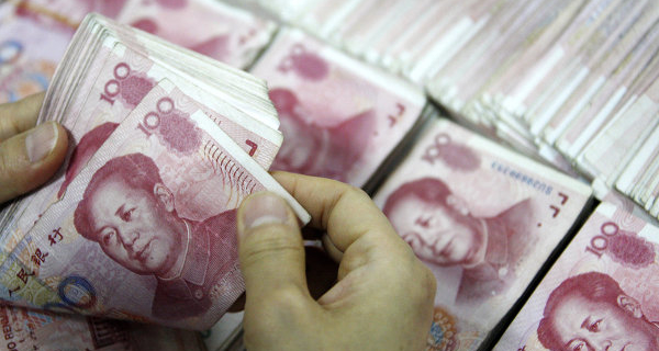 China has sharply lowered its yuan exchange rate against the dollar