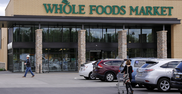 Amazon buy grocery shopping network Whole Foods Market for $13.7 billion